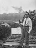 Senator Richard M. Nixon on Roof of Home in Los Angeles, Putting Out Fires Caused by Brush Blaze Reproduction photographique par Allan Grant