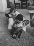 Mike Sibole, Four-Year-Old Recently Blinded to Save His Life, Playing with Father and Brother Reproduction photographique par Stan Wayman