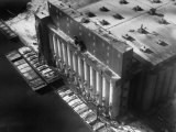 Aerial View of Cargill Grain Elevator with Barges Lined up on the Bank of the Chicago River Reproduction photographique par Margaret Bourke-White