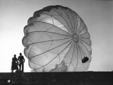 Two Irving Air Chute Co. Employees Struggling to Pull Down One of their Parachutes after Test Jump Reproduction photographique par Margaret Bourke-White