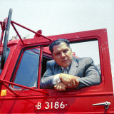 Portrait of Teamsters Union Pres. Jimmy Hoffa Leaning Out Window of Red Truck Premium Photographic Print by Hank Walker