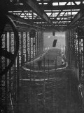 Shipbuilding, 10,000 Ton Merchantman Frames on Overhead Trolley Crane Dropping Plate into Position Fotografie-Druck von William Vandivert