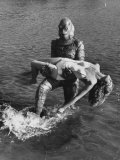 Actress Julia Adams is Carried by Monster, Gill Man, in the Movie, Creature from the Black Lagoon Premium fotografisk trykk av Ed Clark
