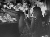 Chorus Girl-Singer Linda Lombard, Resting Her Legs after a Tough Night on Stage Fotoprint av George Silk