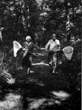 Author Vladimir Nabokov and His Wife Vera Chasing Butterflies Premium Photographic Print by Carl Mydans