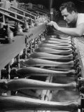Worker Carving Chair Legs, 24 at a Time, at a Tomlinson Furniture Factory Reproduction photographique par Margaret Bourke-White