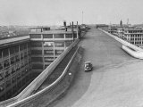 Fiat Car Driving Along the Desolate Street Photographic Print by Carl Mydans
