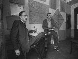 Painter Brion Gysin, Shown W His Paintings in Hotel Room in with Writer William S. Burroughs Fotografisk tryk af Loomis Dean