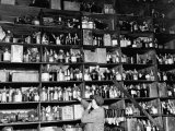 Shelves of Illegal Liquor Stored in the Nypd Property Clerks Office Stretched Canvas Print by Carl Mydans