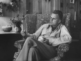 Evangelist, Billy Graham, Sitting in Easy Chair, Talking, in His Home Reproduction photographique par Ed Clark