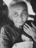 South Vietnamese Refugee Holding Small Child Photographic Print by Carl Mydans