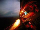 Crew of Us Ac-47 Plane Firing 7.62 Mm Ge Miniguns During Night Mission in Vietnam Reproduction photographique par Larry Burrows