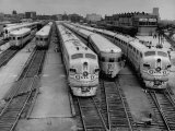 """Men are Loading Up the """"Santa Fe"""" Train with Supplies before They Take-Off Lámina fotográfica por Andreas Feininger"""