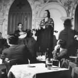 """Fado"" Singer and a Guitarist Entertaining the Audience in the Lisbon Nightclub Stampa fotografica di Bernard Hoffman"