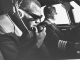 Singer Ray Charles Wearing Earphones While in His Private Plane Reproduction photographique Premium
