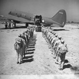 US Armed Forces C46 Cargo Plane Loading Troops and Equipment Photographic Print by Bernard Hoffman