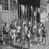 Washington Univ. Rowing Team Showing Up for Practice Lámina fotográfica por J. R. Eyerman
