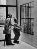 French Actor Jacques Tati Looking at the Names of a Building Premium Photographic Print by Yale Joel