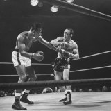 Boxers Ray Robinson and Carmen Basilio Fighting in the Ring Premium Photographic Print by George Silk