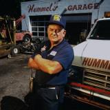 Mechanic Norman Hummel at His Garage Premium Photographic Print by James Keyser