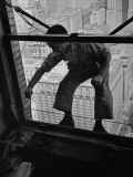 A Window Washer Cleaning the Windows Premium Photographic Print by Peter Stackpole