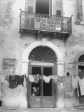 Laundry Hanging in Front of Local Headquarters Premium Photographic Print by Walter Sanders