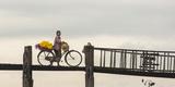 Myanmar, Mandalay. Woman Walks Her Flower-Laden Bicycle across U Bein Bridge Reproduction photographique par Brenda Tharp