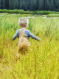 Alaska, 2 Year Old Child Playing in Tall Grass, Summertime Photographic Print by Savanah Stewart
