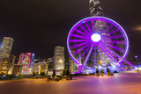 Hong Kong, China. Night Skyline with New Ferris Wheel and Twilight , Purple Reproduction photographique par Bill Bachmann
