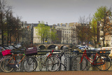 Amsterdam Bicycles on Bridge over Canal Photographic Print by Anna Miller