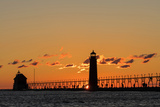Sunset Silhouettes the Grand Haven Lighthouse in Grand Haven, Michigan, Usa Photographic Print by Chuck Haney