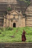 Myanmar, Mingun. a Young Monk Walking Beneath a Massive Temple Wall at Ruins of Mingun Pahtodawgyi Reproduction photographique par Brenda Tharp