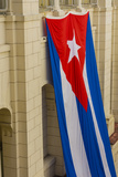 Cuba. Havana. Giant Cuban Flag Hanging in an Interior Courtyard Photographic Print by Inger Hogstrom