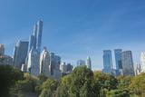 Buildings Along Central Park South Will Wollman Rink in Central Park, New York City, Ny Impressão fotográfica por Greg Probst