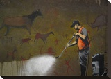 Cleaning Cave Drawings Stretched Canvas Print by  Banksy
