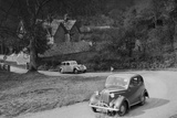 Vauxhall 10 of Miss IM Burton amd Rover of CG Dunham competing in the RAC Rally, 1939 Reproduction photographique par Bill Brunell