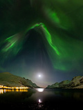 Aurora Borealis Above a Fjord on a Moonlit Night in Norway Photographic Print by Babak Tafreshi