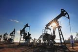 Working Oil Pumps Silhouette against Sun Fotografie-Druck von  Kokhanchikov