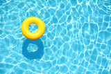 Yellow Pool Float, Ring Floating in a Refreshing Blue Swimming Pool Fotografisk trykk av StacieStauffSmith Photos