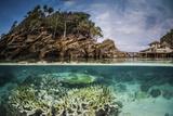 An over under image of Misool Eco Resort and its surrounding bay, Indonesia Fotografisk tryk af Stocktrek Images,