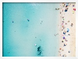 Aerial View of Sandy Beach with Tourists Swimming in Beautiful Clear Sea Water Framed Photographic Print by paul prescott