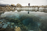 A Climber Hikes Near a Glacial Pool on Lower Ruth Glacier in Denali National Park Fotografisk trykk av Aaron Huey