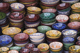 Morocco, Marrakech. Colorfully painted ceramic bowls for sale in a souk, a shop. Lámina fotográfica por Brenda Tharp