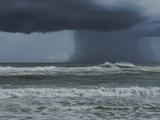 Dark Dramatic Shot of Tropical Storm Coming Ashore at Pensacola, Florida Beach. Water Spout Descend Fotografie-Druck von  forestpath