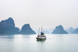 A boat passes through foggy karst landscape in Ha Long Bay, Quang Ninh Province, Vietnam, Indochina Photographic Print by Jason Langley