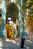 Young Iranian girl in chador taking picture in front of Jameh Mosque, Natanz, Iran, Middle East Photographic Print by James Strachan