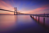 The colors of dawn on  Vasco da Gama Bridge that spans the Tagus River Lisbon Portugal Europe Impressão fotográfica por  ClickAlps