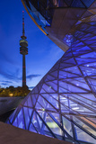 Germany, Bavaria, Munich, BMW Welt company showroom and Olympia Tower, dusk Reproduction photographique par Walter Bibikw