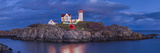 USA, Maine, York Beach, Nubble Light Lighthouse with Christmas decorations, dusk Reproduction photographique par Walter Bibikw
