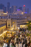 Qatar, Doha, Souq Waqif, redeveloped bazaar area, elevated view with West Bay skyscrapers from one  Reproduction photographique par Walter Bibikw